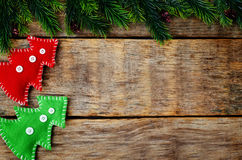 Wood background with Christmas tree and homemade fleece toys Royalty Free Stock Photography