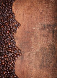 Wood background with Coffee beans Royalty Free Stock Images