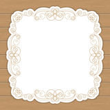Wood background with curly frame Royalty Free Stock Image