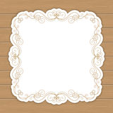 Wood background with curly frame Stock Images
