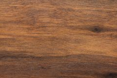 Wood background or dark brown texture. Texture of old wood use as natural background. Top view of brown black american walnut wood stock image