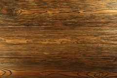 Wood background. dark wood, larch tinted. Selected texture. Stock Photos