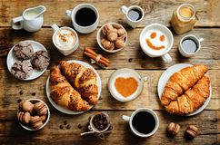 Wood background with different types of coffee and desserts to t Royalty Free Stock Photography