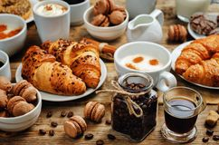 Wood background with different types of coffee and desserts to t Royalty Free Stock Image