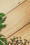 Wood background with dill and pepper frame Royalty Free Stock Photography