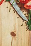 Wood background with dill and pepper frame Royalty Free Stock Photo
