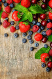 Wood background with fresh berries, strawberries, blueberries, c. Herries and raspberries. the toning. selective focus Royalty Free Stock Photos
