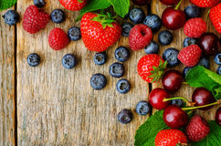 Wood background with fresh berries, strawberries, blueberries, c. Herries and raspberries. the toning. selective focus Stock Photo