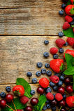 Wood background with fresh berries, strawberries, blueberries, c. Herries and raspberries. the toning. selective focus Stock Image