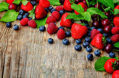 Wood background with fresh berries, strawberries, blueberries, c. Herries and raspberries. the toning. selective focus Royalty Free Stock Photography