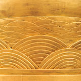 Wood Background, Golden Carved Wood of Arc Patterns. Shiny Old Golden Carved Wood of Arc Patterns around Column (background&#x29 Royalty Free Stock Image