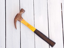 Wood background with a hammer Stock Images