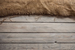 Wood background with hessian textile Royalty Free Stock Photography