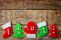 Wood background with homemade fleece toys Stock Image