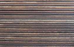 Wood background. With horizontal dark brown, tarred planks Stock Photography