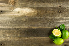 Wood background with limes Stock Photo