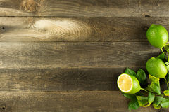 Wood background with limes Royalty Free Stock Photography