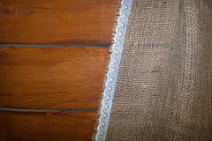 Wood background and linen fabric with place for text Royalty Free Stock Photography