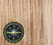 Wood background  and mall pocket compass Stock Image