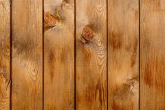 Row of tinted brown wooden boards with knots. Wood background. Row of tinted brown wooden boards with knots Stock Photos