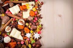 Wood background with sweets and chocolate Royalty Free Stock Photos