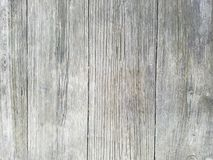 Wood background texture, closeup of table outdoors. Vertical planks. Surface has four large sections. stock image