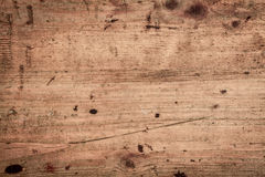 Wood background texture. Of smooth wooden boards scored and stained with age Stock Image
