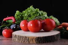 Wood background and tomato. Vegetables Food Concept and Decoration stock images
