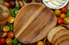 Wood background with tomatoes, Basil, mozzarella, bread. Toning. selective focus Royalty Free Stock Photo