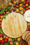 Wood background with tomatoes, Basil, mozzarella, bread. Toning. selective focus Stock Photo