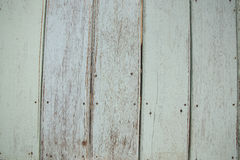 Wood background. A weathered wood panel background with nails heads Stock Images