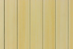 Wood background. Yellow wood panel background. Painted textures Stock Image