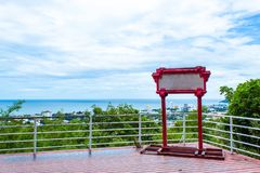 Wood Badge on the wooden terrace sea view and city. Wood Badge on the wooden terrace sea view and city , Thailand royalty free stock photos