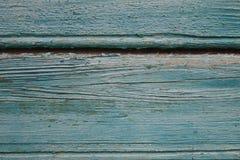 Wood bakgrund för turkos - målade träplankor för skrivbord bordlägger väggen eller golvet arkivbilder