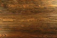 Wood bakgrund mörkt trä, tonad lärk Utvald textur Arkivfoton