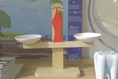 Wood model of balance. A wood balance toy put on a sideboard with another toys in classroom of kindergarten stock photography