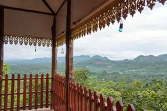 The wood balcony with wood fretting and nature and mountain back. One of the most important places in the district of Li, it is also a viewpoint of the city Royalty Free Stock Photo