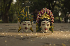 Wood Balinese Masks. Couple of wood Balinese mask in the floor hitting by sunlight Stock Photography