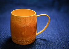 Wood bamboo cup on the dark background Stock Images