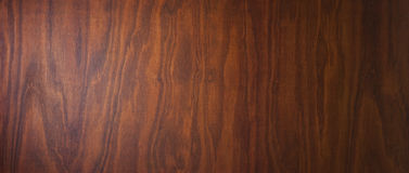 Wood Banner Background. A wood banner banner background with wood grain and warm tones Stock Image
