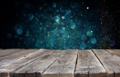Wood baord and dark blue bokeh lights in background Royalty Free Stock Photo