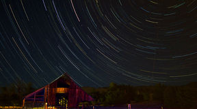 Wood barn with star trails Stock Images
