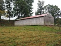 Wood barn with tin roof Royalty Free Stock Image