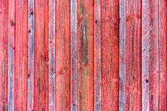 Wood barn wall with red peeling flaking color. Stock Image
