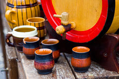 Wood barrel with cups. Wooden barrel with group of ceramic pottery Royalty Free Stock Photo