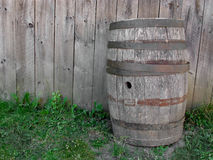 Wood barrel and wood wall. Royalty Free Stock Photography