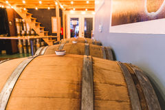 Wood Barrels in a Tap House or Brew Pub. Wooden barrels or casks inside a brewpub, tap house, or restaurant Stock Photos