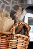 Wood in basket Stock Images