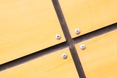 Wood batten annexation. Intersection of four wood batten fixed with screws royalty free stock images