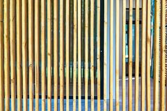 Wood battens were settle on the wall for building partition and background. Wood battens were settle on the wall for building  partition and background stock photo